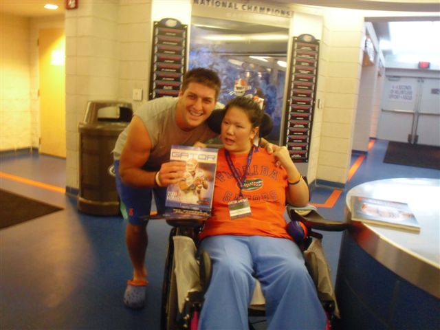 Queena meet with Gator quarterback Tim Tebow (October 2009)